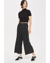 TOPSHOP | Black Belted Spot Plisse Trousers | Lyst