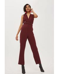 b55285f8f5a TOPSHOP Eyelet Wrap Jumpsuit in Red - Lyst