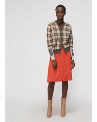 Le Kilt Orange Pleated Skirt