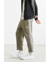 7f59f8fcb3af0 adidas Originals Superstar Relaxed Cropped Track Pant in Green for ...