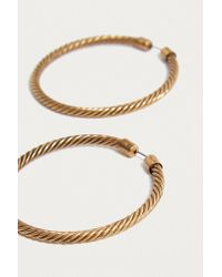 Urban Outfitters - Metallic Large Twisted Hoop Earrings - Lyst