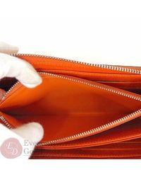 Louis Vuitton Orange Zippy Leder Portemonnaies