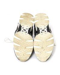 Scarpe da ginnastica in tela grigio di Chanel in Gray