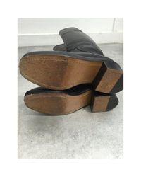 Stivali in pelle nero di Chanel in Black