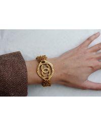 Bracelets CC en Métal Doré Chanel en coloris Metallic