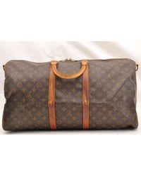 Borsa da viaggio in tela marrone Keepall di Louis Vuitton in Brown