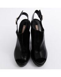 Zuecos en cuero negro Michael Kors de color Black