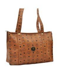 Bolsa de mano en cuero marrón MCM de color Brown