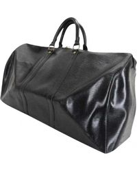 Louis Vuitton - Black Pre-owned Leather Travel Bag - Lyst