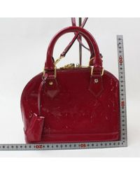 Borsa a mano in vernice rosso di Louis Vuitton in Red
