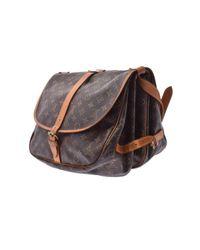 Sac à main Saumur en Toile Marron Louis Vuitton en coloris Brown