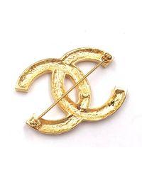 Broche en Chapado en oro Dorado Chanel de color Metallic