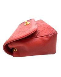 Bolsa de mano en cuero rojo Timeless/Classique Chanel de color Red