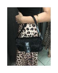 Bolsa de mano en lona negro Baguette Fendi de color Black