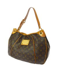 Louis Vuitton - Brown Pre-owned Cloth Handbag - Lyst