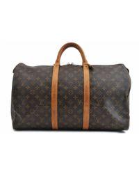 Borse da viaggio in tela marrone Keepall di Louis Vuitton in Brown