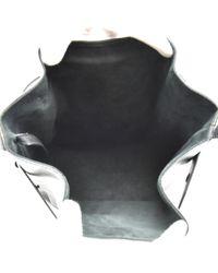 Sac à main en Cuir Noir Louis Vuitton en coloris Black