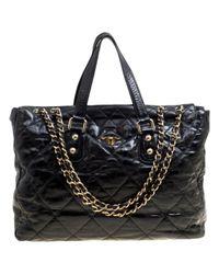 Chanel Black Lackleder Handtaschen