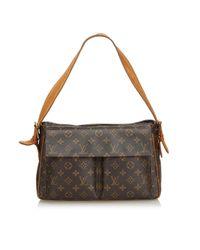 Bolso Cite de Lona Louis Vuitton de color Brown