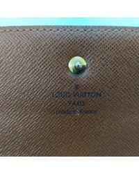 Portefeuilles Louis Vuitton en coloris Brown