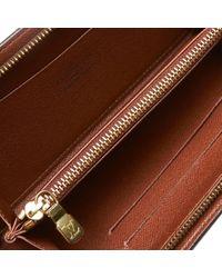 Cartera en lona marrón Zippy Louis Vuitton de color Brown