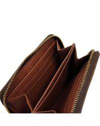 Cartera Zippy de Lona Louis Vuitton de color Brown