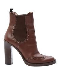 Boots en cuir Miu Miu en coloris Brown