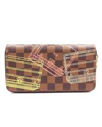 Portafogli in pelle marrone Zippy di Louis Vuitton in Brown