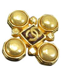 Spilla in metallo dorato di Chanel in Metallic