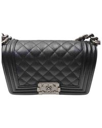 Bolsa de mano en cuero negro Boy Chanel de color Black