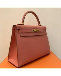 Bolsa de mano en cuero rosa Kelly 32 Hermès de color Multicolor