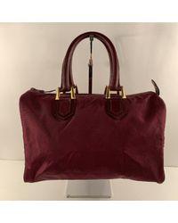 Bolsos de viaje en lona rojo Dior de color Red