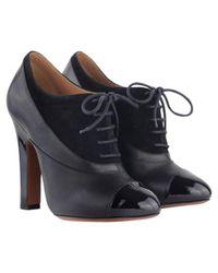 Alaïa Black Leather Lace Up Boots
