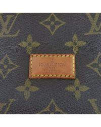 Sac à main Saumur en Toile Marron Louis Vuitton en coloris Multicolor