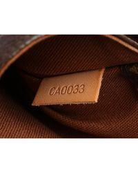 Bolsa clutch en lona marrón Louis Vuitton de color Brown