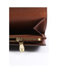 Cartera en lona marrón Sarah Louis Vuitton de color Brown