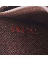 Louis Vuitton Brown Zippy Leinen Portemonnaies