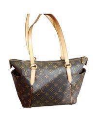 Bolsa de mano en lona marrón Totally Louis Vuitton de color Brown