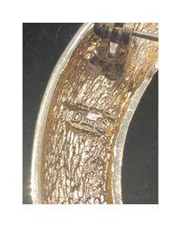 Broche en metal dorado Dior de color Multicolor