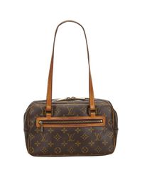 Bolso Cite Louis Vuitton de color Brown