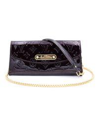 Louis Vuitton Black Eva Lackleder Clutches