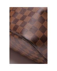 Bolsa de mano en lona Neverfull Louis Vuitton de color Brown