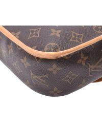 Sac à main en Toile Marron Louis Vuitton en coloris Brown