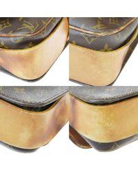 Borsa a mano in tela marrone di Louis Vuitton in Brown