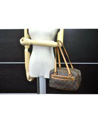 Borsa a mano in pelle marrone Cite di Louis Vuitton in Multicolor