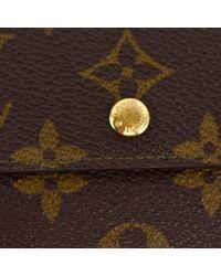 Cartera en lona marrón Louis Vuitton de color Brown
