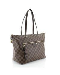 Bolsa de mano en lona marrón Iéna Louis Vuitton de color Brown