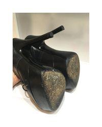 Boots en Cuir Noir Louis Vuitton en coloris Black