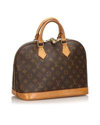 Bolsos en lona marrón Alma Louis Vuitton de color Brown