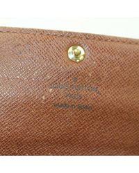 Portafoglio in tela marrone Virtuose di Louis Vuitton in Brown